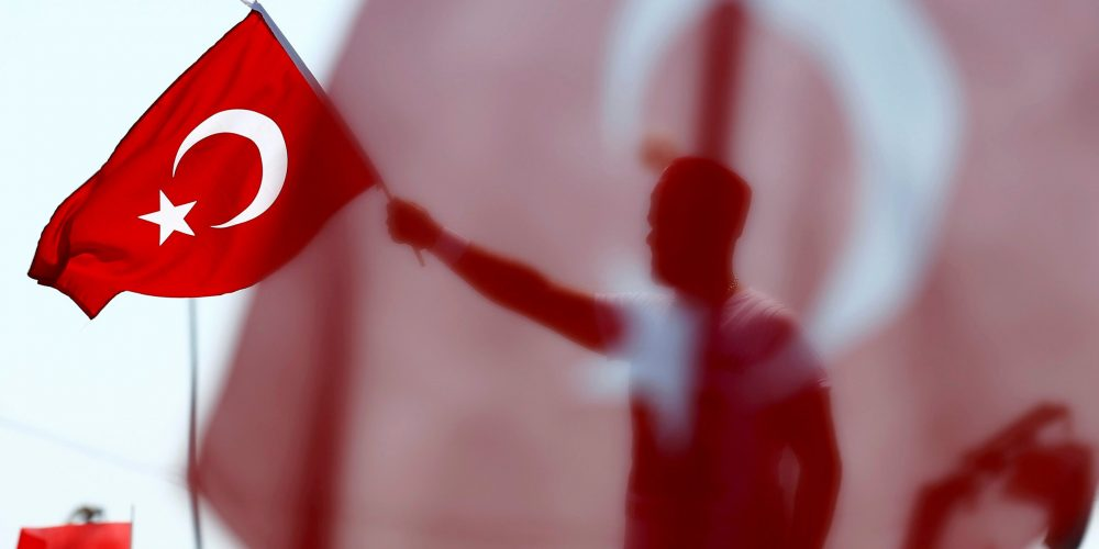 A man waves Turkey's national flag during the Democracy and Martyrs Rally, organized by Turkish President Tayyip Erdogan and supported by ruling AK Party (AKP), oppositions Republican People's Party (CHP) and Nationalist Movement Party (MHP), to protest against last month's failed military coup attempt, in Istanbul, Turkey, August 7, 2016. REUTERS/Umit Bektas     TPX IMAGES OF THE DAY